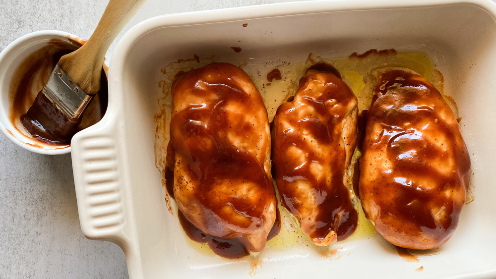 BBQ chicken recipe brushed with BBQ sauce