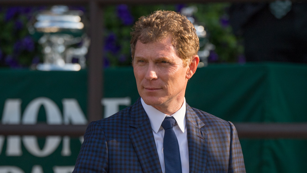 bobby flay standing outside in suit