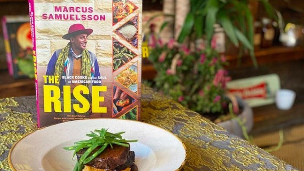 Chef Marcus Samuelsson's new cookbook The Rise with plate of food