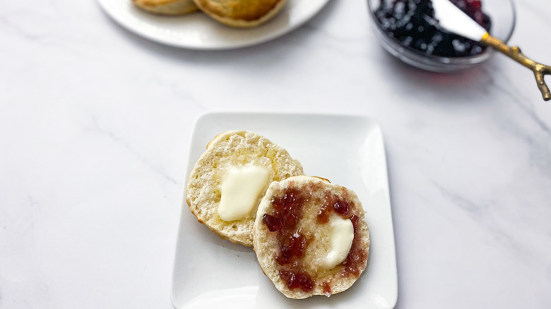 biscuit with jelly and butter on a plate