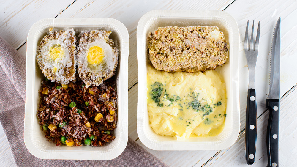 Frozen TV dinners in white trays