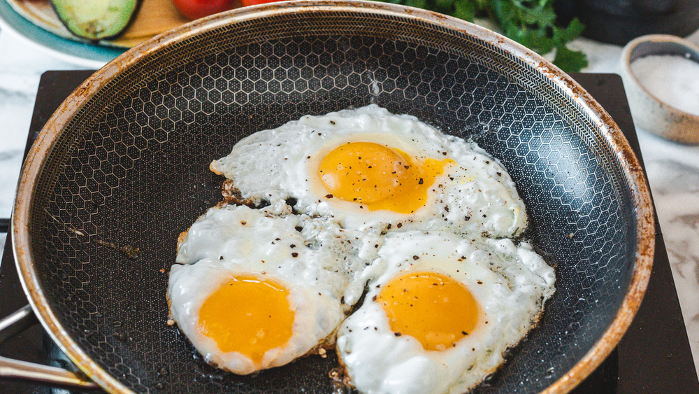 Sunny-side-up eggs in pan