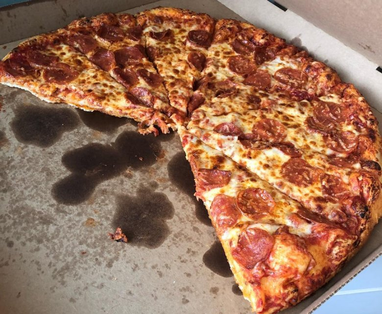 A Lot Of Oil Is Used To Make The Pizza