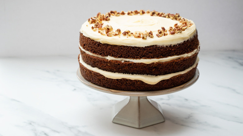 Carrot cake with pecans on top