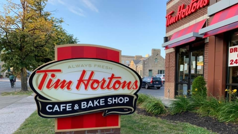 The Reason Photos Of Tim Hortons' Founder Are No Longer In Restaurants