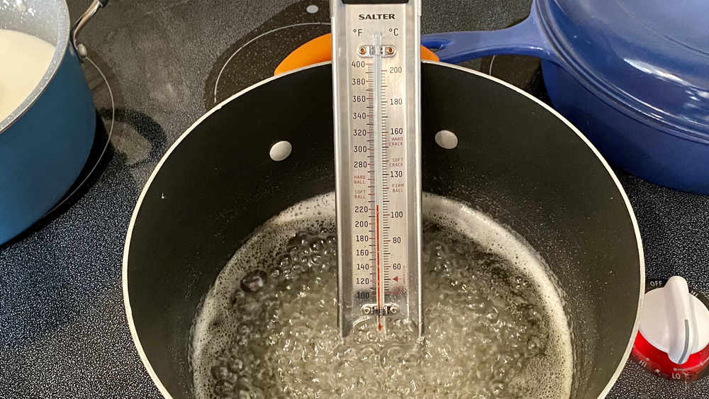 Sugar syrup with candy thermometer