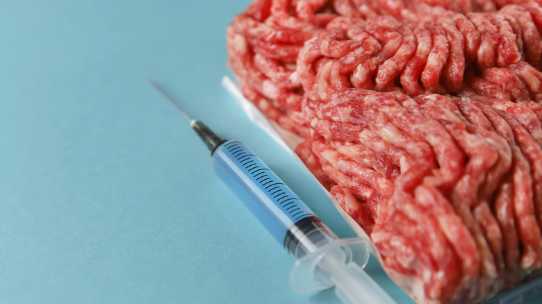 Ground meat with chemical additive for bologna