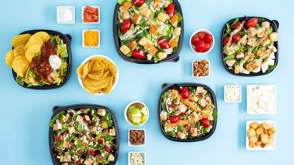Wendy's salads on blue background