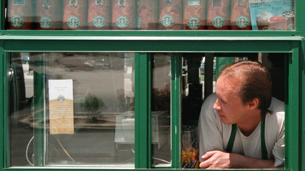 man leaning out of Starbucks drive-thru window